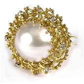 A mabe pearl and diamond dress ring, the central pearl