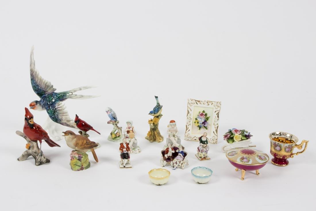 A collection of miniature porcelain figures, birds,