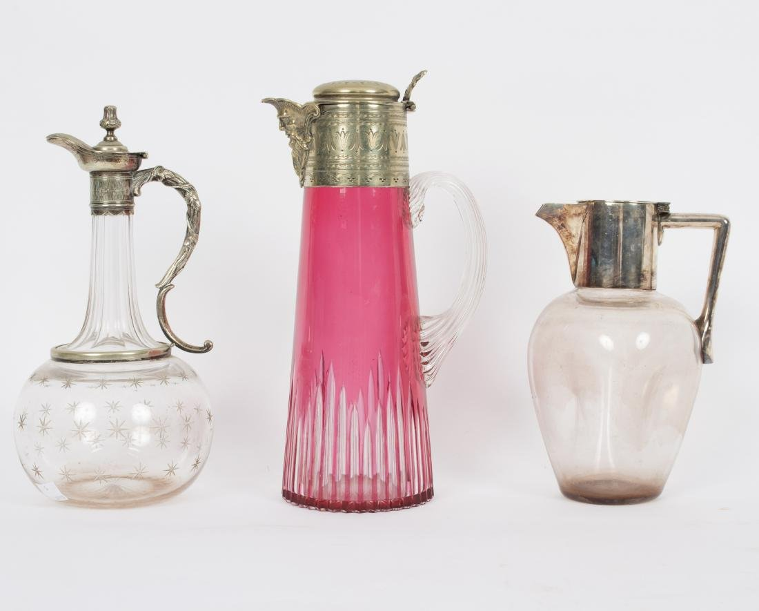 A ruby tinted glass claret jug with plated mounts, 28cm
