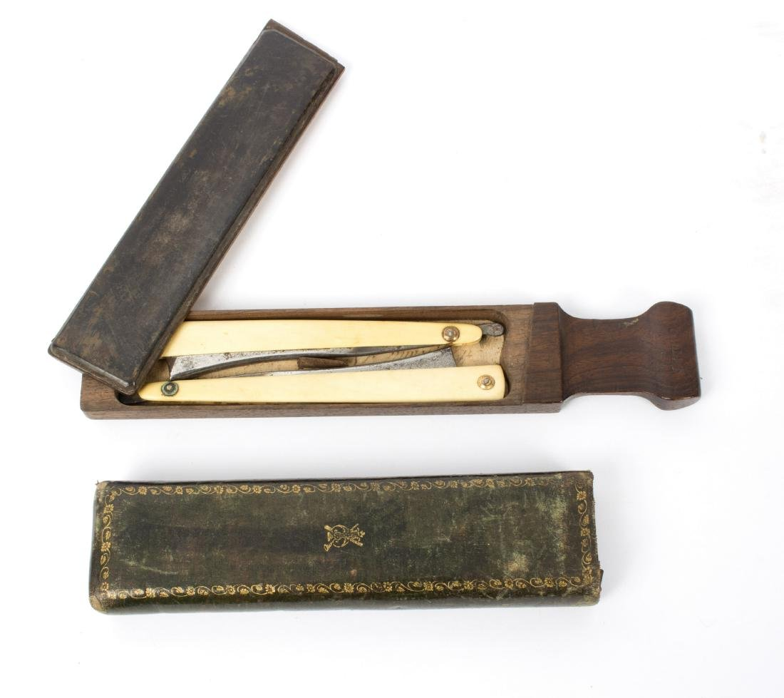 A French razor box, by Gillett, containing two razors,