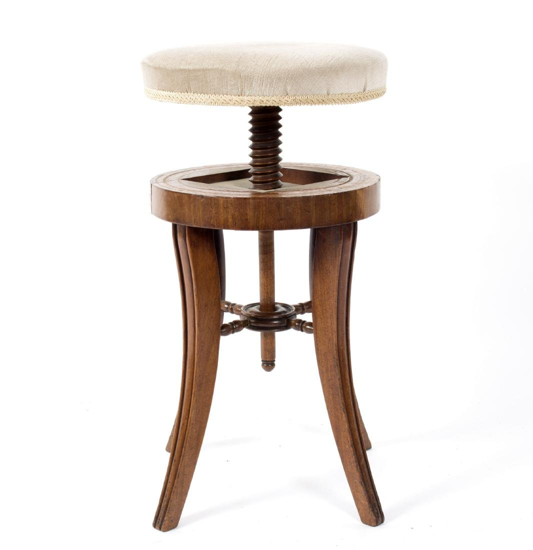 A 19th Century two-tier tripod table, the circular top