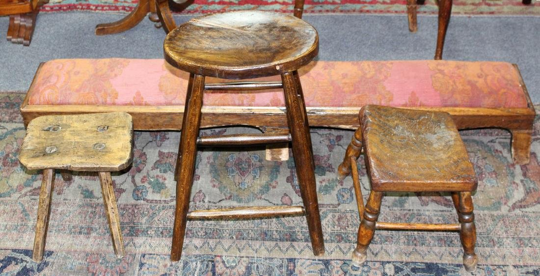 A stool with oval elm seat, 36cm wide, two low stools