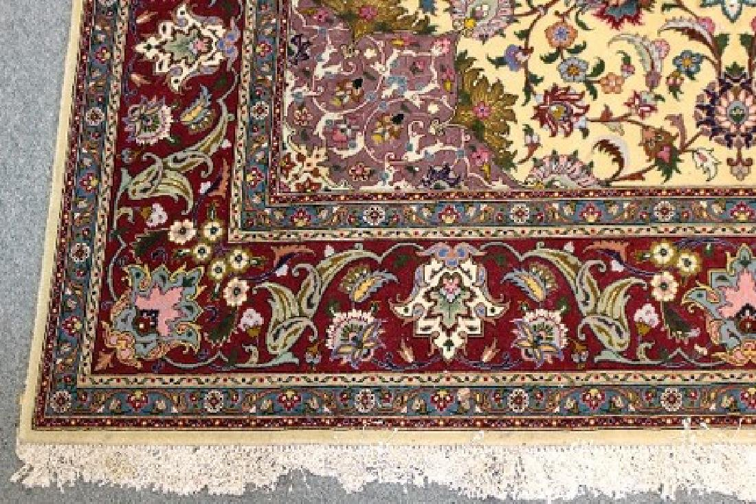 A modern Persian carpet with central floral field on a