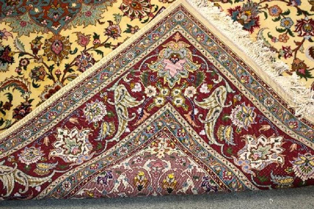 A modern Persian carpet with central floral field on a - 2