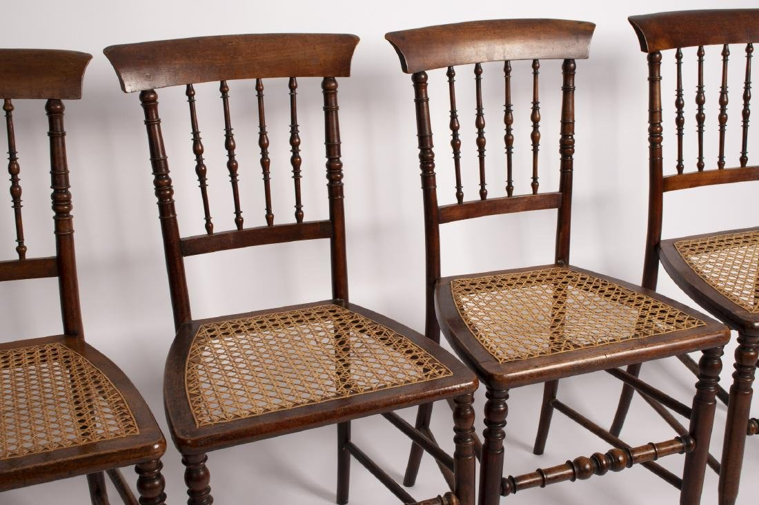 A set of four late Victorian spindle back chairs, with
