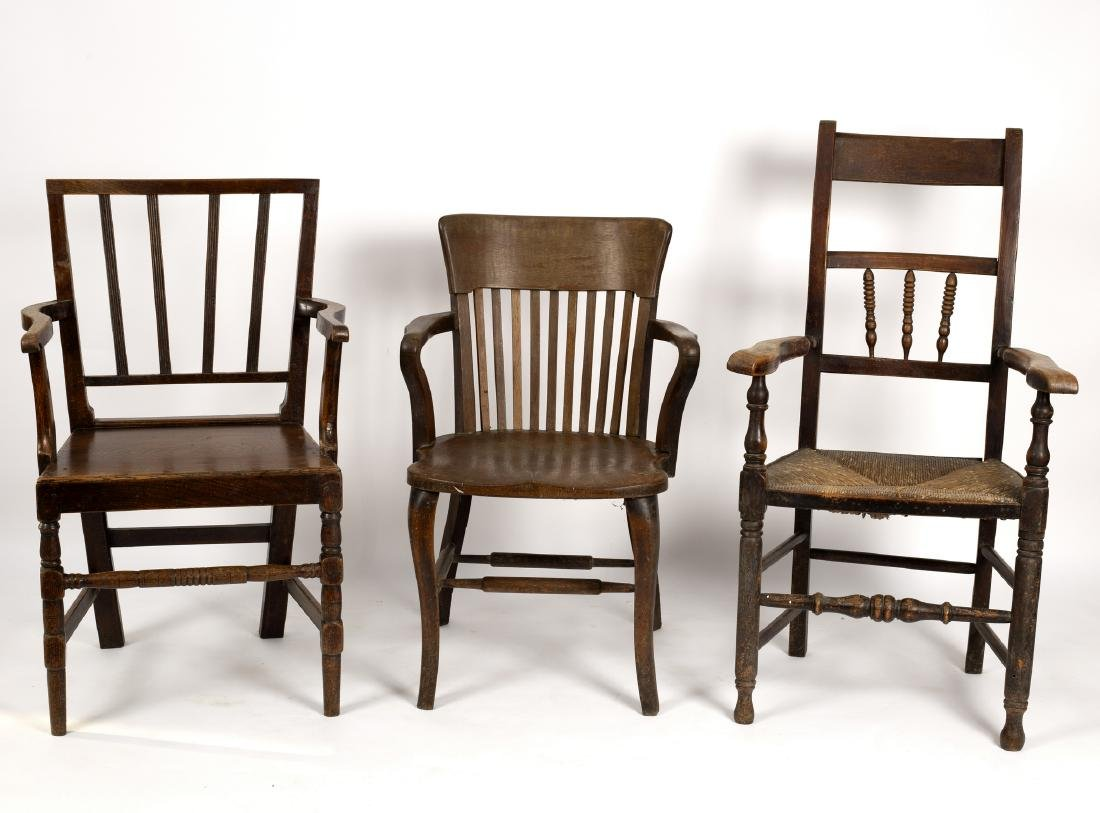 Three open armchairs