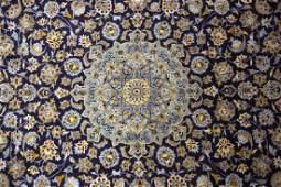 A Kashan carpet, the central pale blue medallion to a