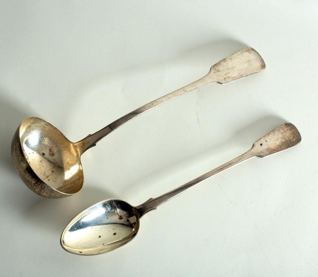 A Victorian silver fiddle pattern ladle and a similar