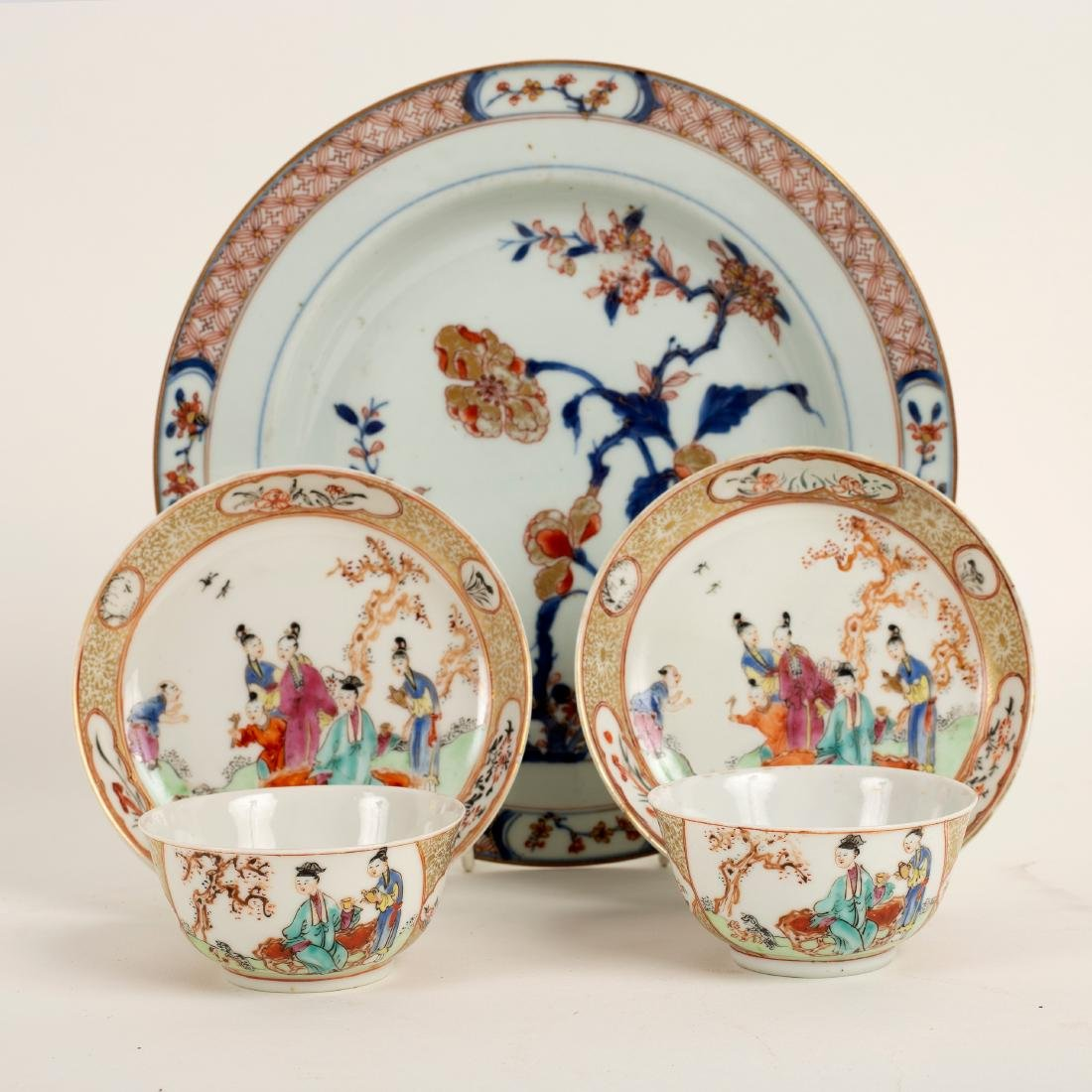 A pair of 18th Century Chinese tea bowls and saucers,