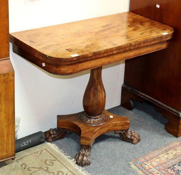 An early 19th Century D-shaped tea table on octagonal