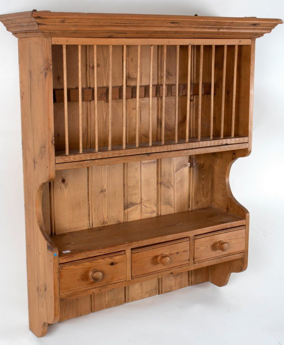 A Victorian pine hanging plate rack with three drawers,