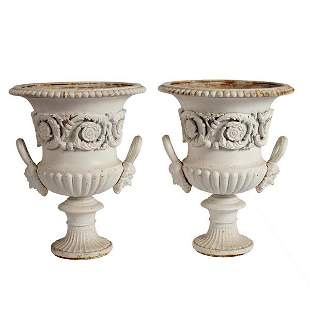 A pair of cast iron campana shaped urns, painted white,