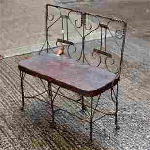 A wirework jardiniere stand of bench form, 57cm wide