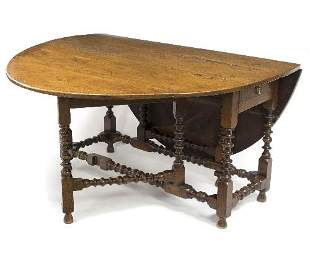 An 18th Century oak two-flap table, on bobbin turned