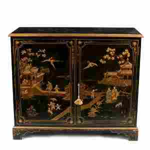 A chinoiserie decorated side cabinet in gilt and green