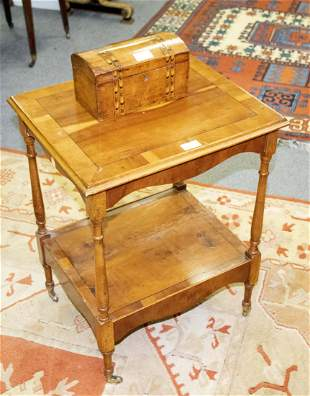 A yew wood two-tier table and a tea caddy
