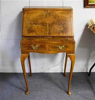 A crossbanded burr wood bureau, the hinged fall flap