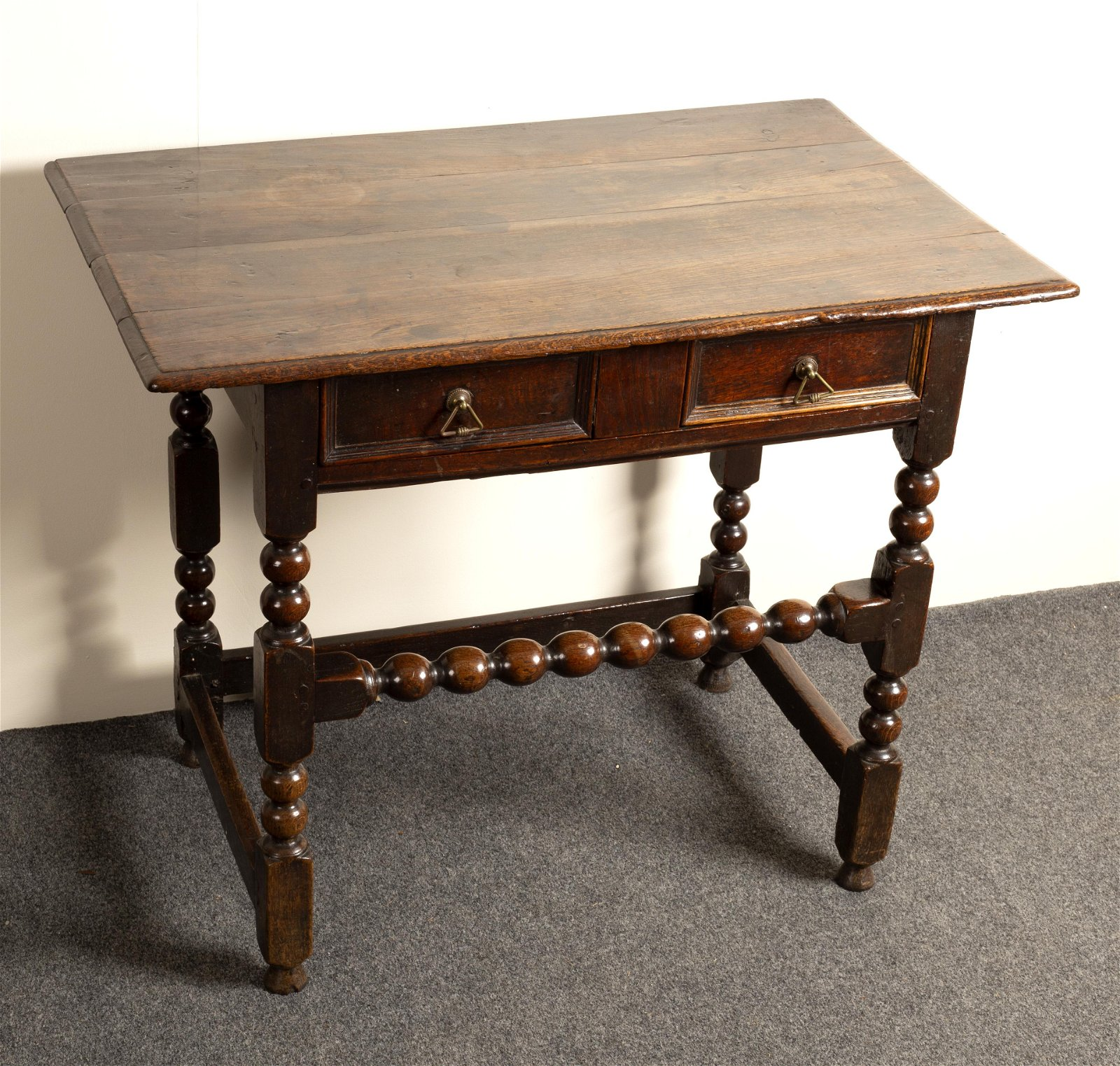 A William and Mary rectangular oak table, the top with