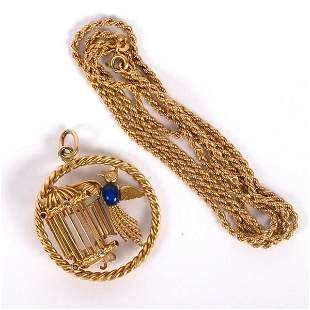 An 18ct gold and gem set pendant modelled as a bird