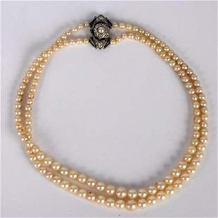 A two-row pearl necklace, the rows of graduated pearls