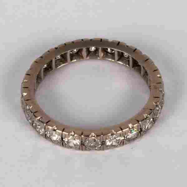A diamond eternity ring set in white precious metal