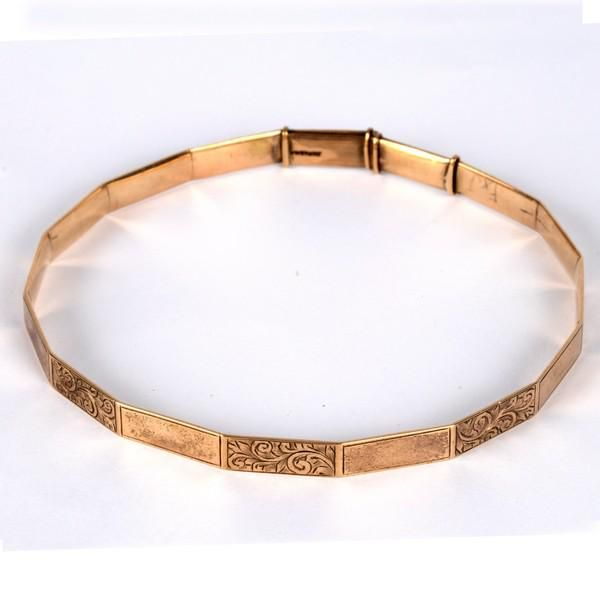 A 9ct gold arm bangle, of polygonal shape with
