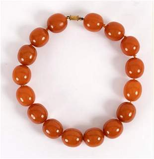 An amber necklace of large slightly oval beads,