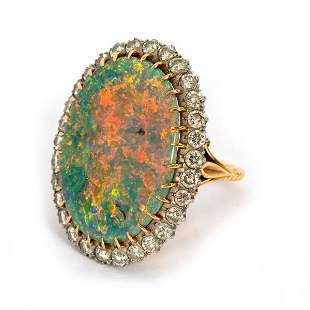 An opal and diamond cluster ring, the large oval opal