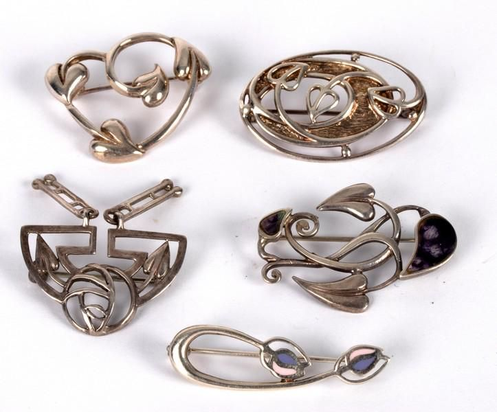 Five Charles Rennie Mackintosh style brooches, one with