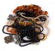 A quantity of costume jewellery including amber bead