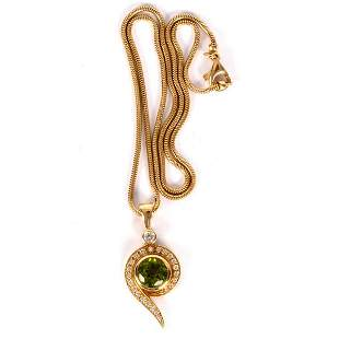 A peridot and diamond pendant by Catherine Best,