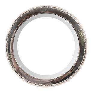 A silver framed circular mirror Mappin Webb London