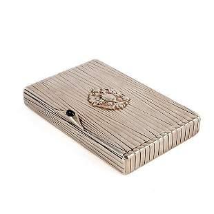 A Russian silver and silver gilt cigarette box with