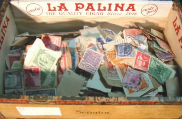 12: Cigar box full of used postage Stamps