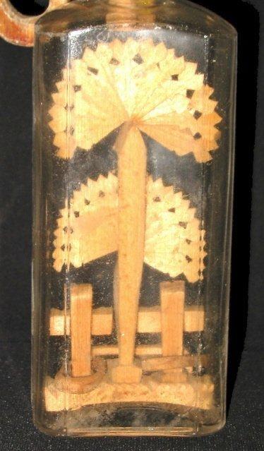 260: Folk Art Wood Carving inside Bottle ©