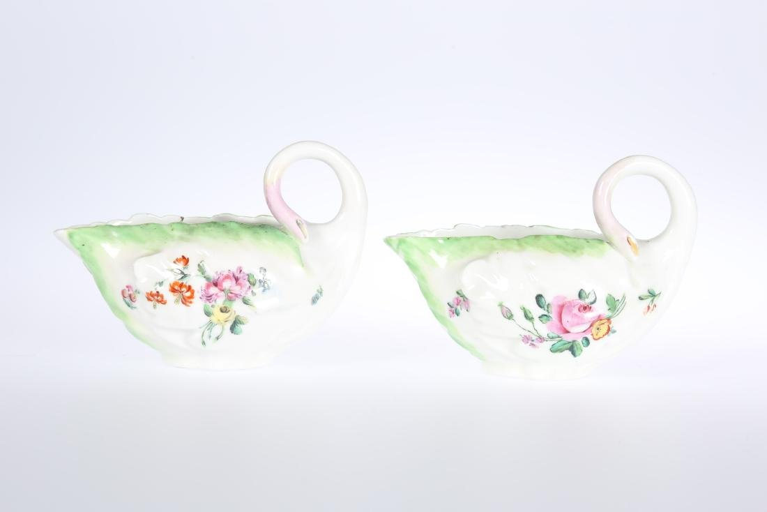 A PAIR OF DERBY COS LETTUCE LEAF MOULDED SAUCE BOATS,