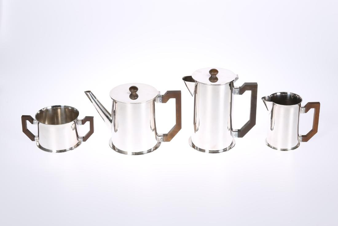 A VINTAGE ENGLISH WHITE METAL FOUR PIECE TEA AND COFFEE