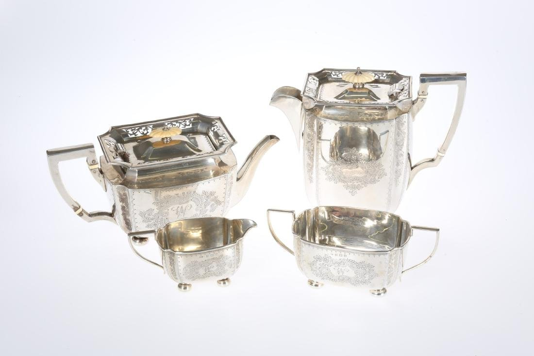 AN EDWARDIAN SILVER FOUR PIECE TEA SERVICE, WILLIAM