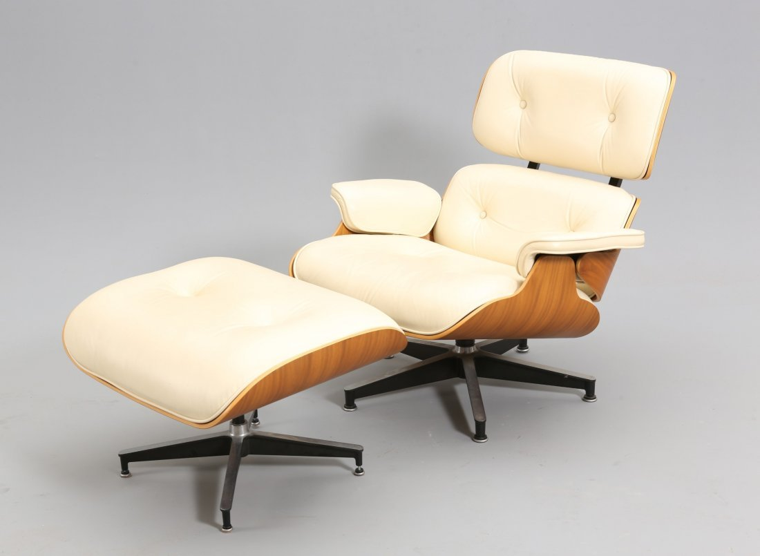 AN EAMES SWIVEL CHAIR AND MATCHING STOOL, with buttoned