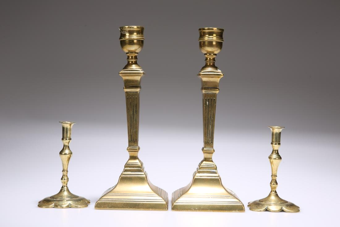 TWO PAIRS OF BRASS CANDLESTICKS: the first early 19th