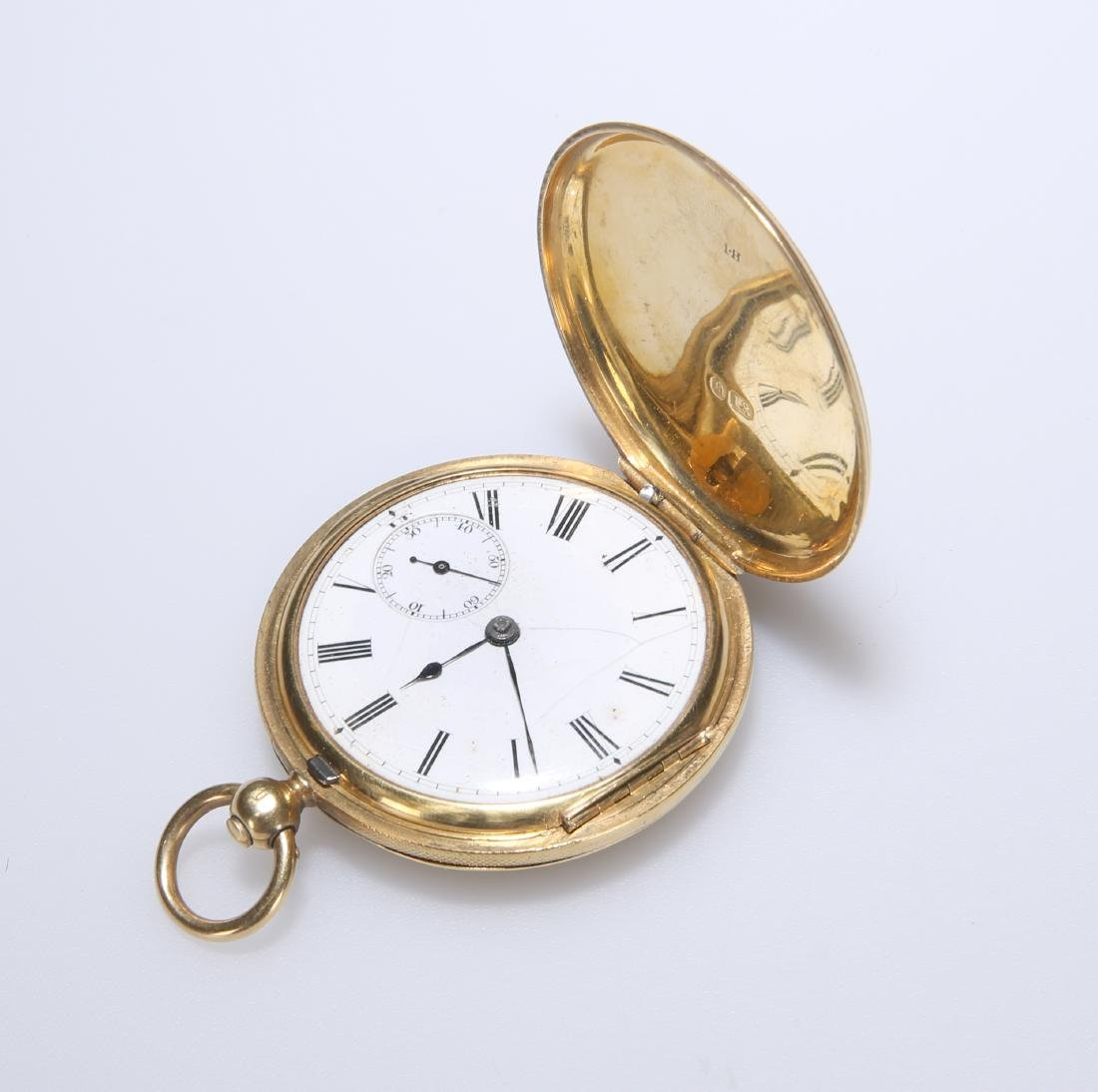 AN 18CT GOLD HUNTER DRESS POCKET WATCH. Circular white