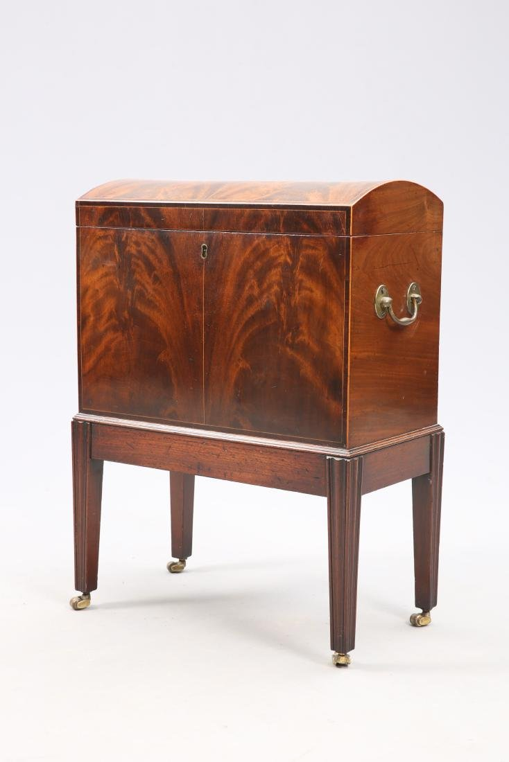 A GEORGE III MAHOGANY CELLARETTE, with domed top, the