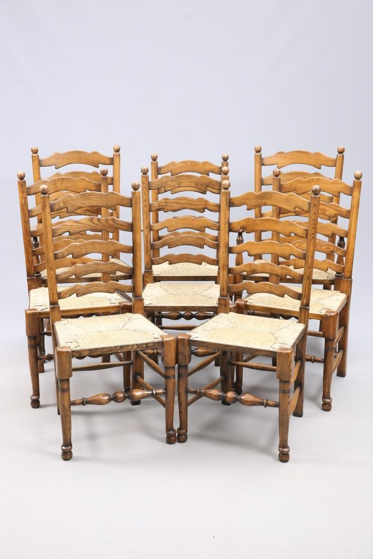 A SET OF EIGHT OAK AND RUSH SEATED LADDERBACK DINING