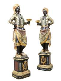 A PAIR OF ITALIAN POLYCHROME CARVED WOODEN TORCHERE