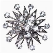 A MID VICTORIAN DIAMOND SET STAR PENDANT, set to the