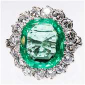 AN EMERALD AND DIAMOND CLUSTER RING the large oval cut