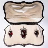 AN EARLY VICTORIAN GARNET AND DIAMOND SET DEMIPARURE