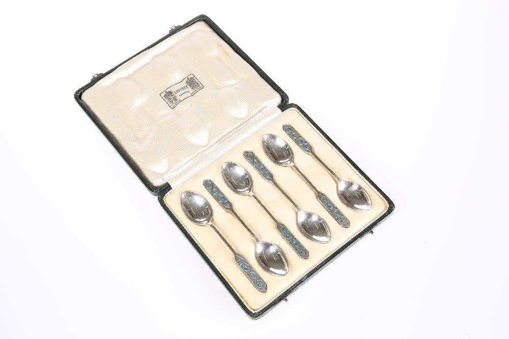 A SET OF SIX LIBERTY & CO SILVER AND ENAMEL SPOONS,