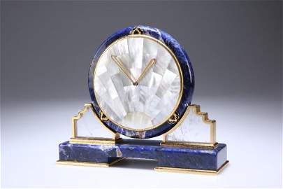 A CARTIER LAPIS LAZULI AND MOTHER-OF-PEARL SUNBURST