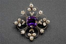 AN AMETHYST AND DIAMOND BROOCH, the central cushion cut